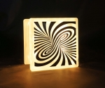 LED glass block lamp with swirl pattern decal