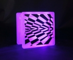 Checkerboard optical illusion decal on glass block LED light