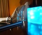 LED light glass block GloBlock on bedside table