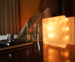 Glass block LED light GloBlock on bedside table