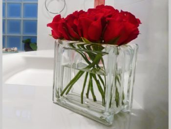 Glass block vase with red roses