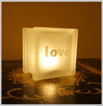 Glass block glass tealight candle holder with love motif