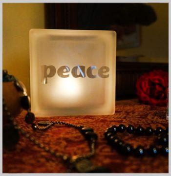 Glass block tealight with peace motif