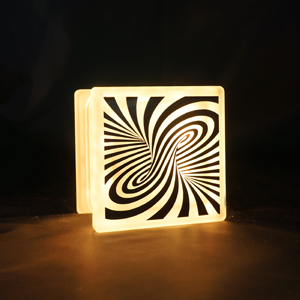 Glass block LED light with swirling opticial illusion decal