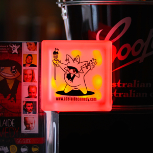 Glass block LED light with customised Adelaide Comedy logo