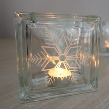 Glass block tea light candle holder with snowflake design