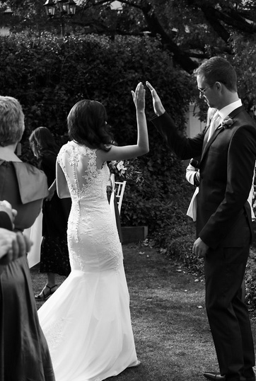 high five bride and groom